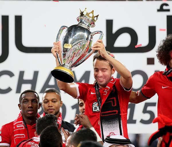 Everton Ribeiro raising the Arabian Gulf Supercup