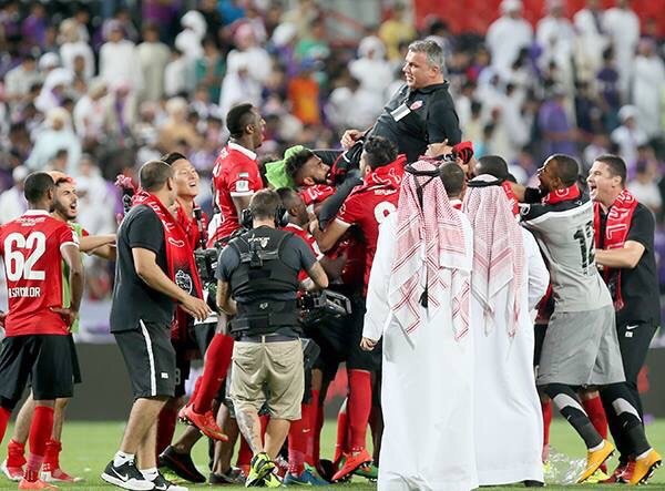 Al Ahli players congratulating their coach Cosmin Olaroiu