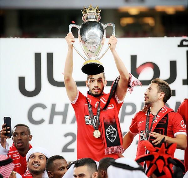 Majed Hassan raising the Arabian Gulf Supercup